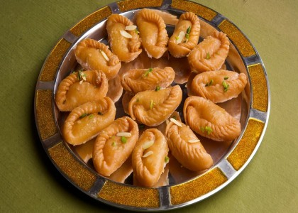 gujiya in sugar syrup